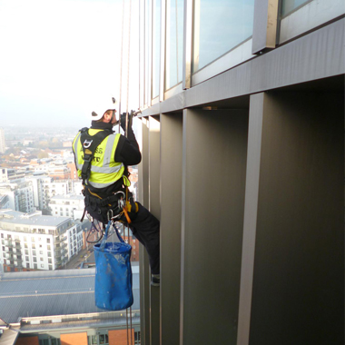 maintenance of the side of a building, glass and facade
